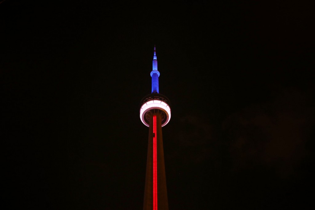 TORONTO, ON - NOVEMBER 13 - The CN Tower lit up with the colours of the French Flag in support of France in the face of tragedy, on November 13, 2015 Cole Burston/Toronto Star