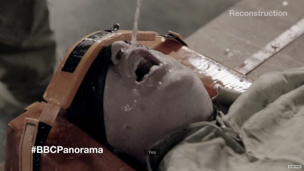 [Still from a BBC reconstruction of waterboarding.]