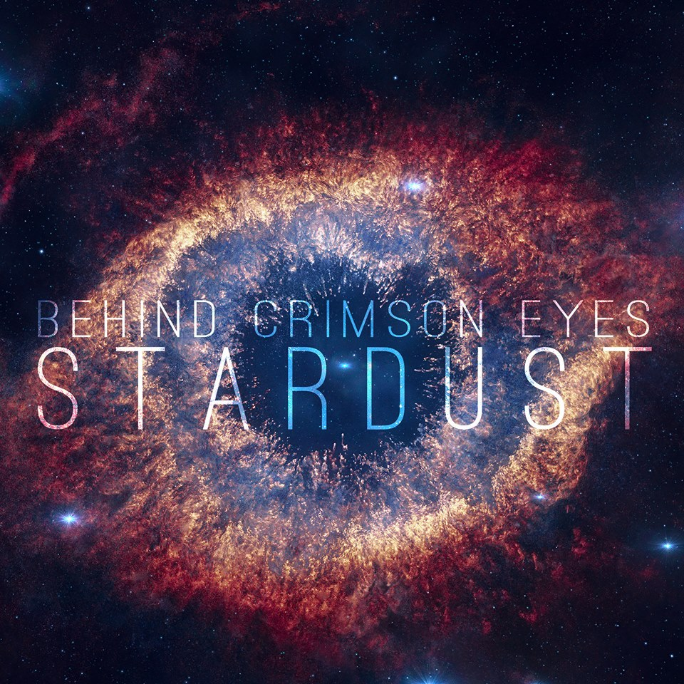 """[A colour-filtered photo of the Helix Nebula (NGC 7293), with the words """"Behind Crimson Eyes"""" and """"Stardust"""" translucently superimposed.]"""
