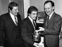 "[Photo taken in 1983 of Roy McMurtry, Roy Romanow, and Jean Chrétien posing with an electric kettle in a recreation of the famous ""Kitchen Accord"" meeting.]"