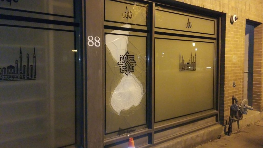 [A photo of the front of Masjid Toronto, showing the vandalism damage.]